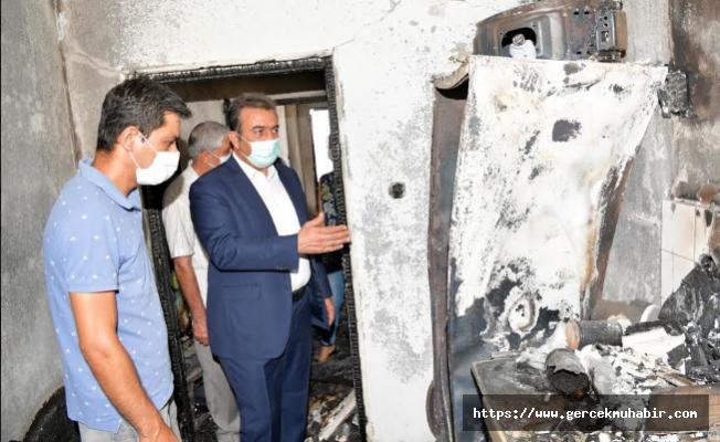 Soner Çetin evi yanan aileye yardım elini uzattı